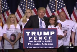 Trump welcomes 'Angel Moms' on stage