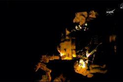 NASA astronauts install adapters on ISS