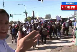 Arizona students walk to out canvass