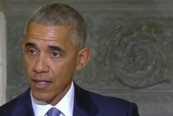 Obama issues stern warning