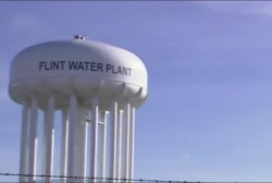Four more officials charged in Flint water...