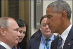 Obama warned Putin to back off from cyber...