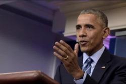 Obama, Trump spar over theoretical third term