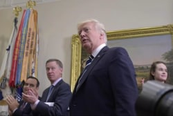 Trump hits new job approval low in poll