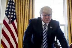 Officials: No policy from Trump on Russian...