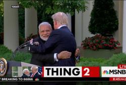 Trump and Indian Prime Minister Modi hug...