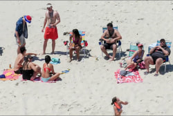 Christie vacationing on closed beach...