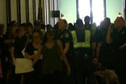 Police Arrest Protesters Outside Senate...