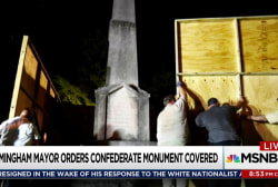 City sued for covering Confederate monument