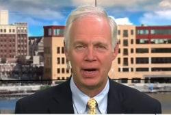 Senator defends bill, says it would...