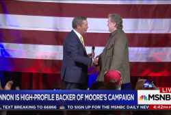 Bannon standing by Roy Moore