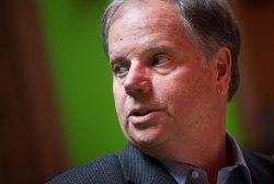 Should Doug Jones focus more on the Moore...