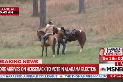 Roy Moore arrives on horseback to vote