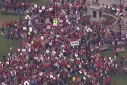 Thousands of teachers walk out in Arizona, Colorado