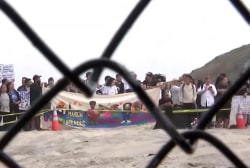 Migrants gather at U.S.-Mexico border to seek asylum