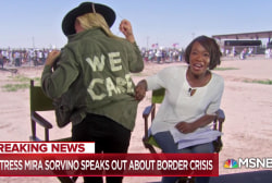 Mira Sorvino wears jacket saying 'WE CARE' to rally for migrant kids