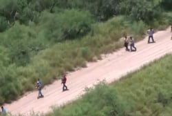 Migrants use rope and homemade rafts to cross the border