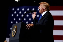 Trump maintains support for Kavanaugh at rally