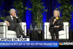 Clintons back in spotlight, have sharp words for Trump