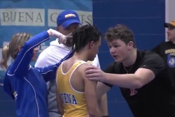 High school wrestler forced to cut dreadlocks or forfeit match