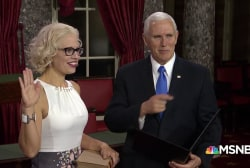 Arizona Senator Sinema sworn into office on law book