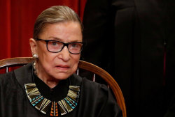 Justice Ginsburg misses Supreme Court oral arguments for first time