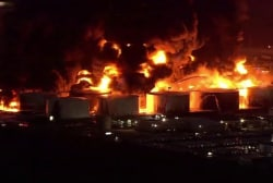 Houston uneasy beneath black plume of days-long chemical fire