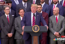 Trump presides over 'racially-divided scene' at Sox visit