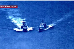 US and Russia point fingers after warships nearly collide