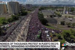 Massive turnout for Puerto Rico protest; Governor flounders on TV