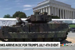 Trump gets long sought military spectacle by hiding the price tag