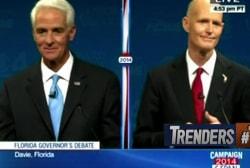 Rick Scott delays debate over Crist's fan