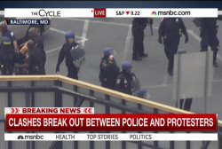Police and protesters clash in Baltimore