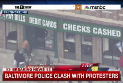 Looting, injuries amid protests in Baltimore