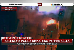 Baltimore police begin to enforce curfew