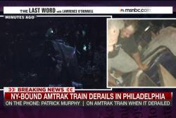 Rescuers still entering train cars