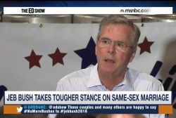 Bush takes tougher stance on same-sex...