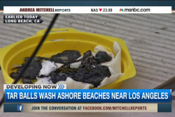Southern Calif. coast scarred with tar balls