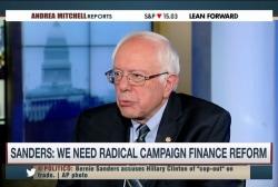 Bernie Sanders draws contrast with Clinton