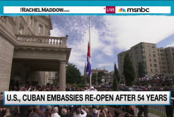 Cuban embassy official with flag-raising