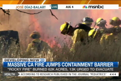 Calif. fire jumps containment barrier