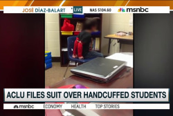 ACLU files suit over handcuffed students