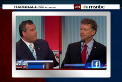 Paul, Christie clash over surveillance