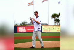 Joe tosses first pitch, gets his own...