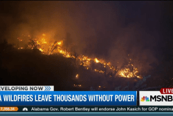 Western wildfires force thousands to evacuate