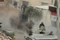 Kerry joins talks to end Syrian war 'hell'
