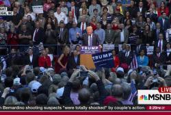 Trump interrupted 10 times, ends speech