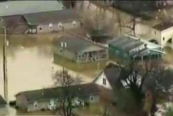 Death toll rises to 14 from flooding