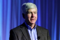 Calls grow for Michigan governor's...
