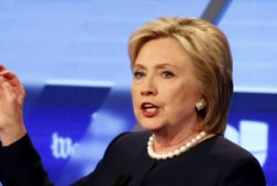 Clinton distances herself from Pres. Obama